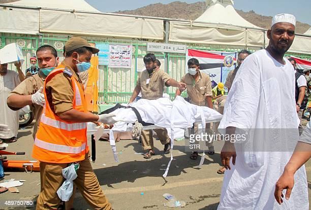 Saudi emergency personnel transport a body on a stretcher at the site where at least 450 were killed and hundreds wounded in a stampede in Mina near...