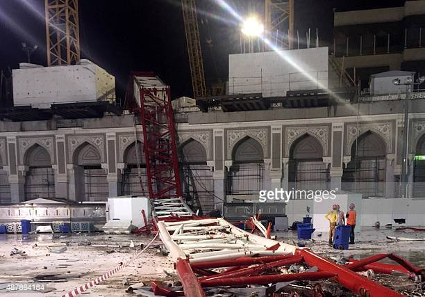 Saudi emergency teams stand next to a construction crane after it crashed into the Grand Mosque of Saudi Arabia's holy Muslim city of Mecca on...