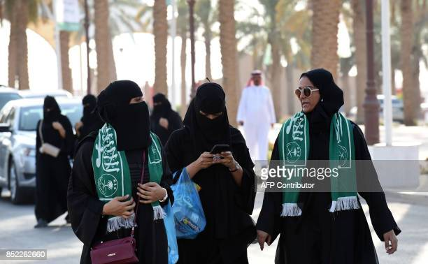 Saudi families arrive outside a stadium to attend an event in the capital Riyadh on September 23 2017 commemorating the anniversary of the founding...