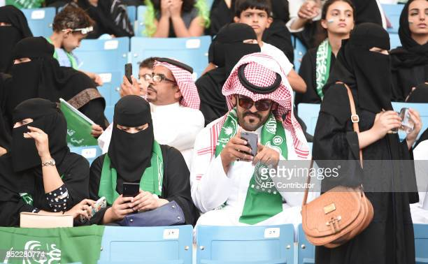 Saudi families sit in a stadium to attend an event in the capital Riyadh on September 23 2017 commemorating the anniversary of the founding of the...