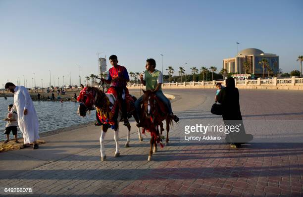 Saudi families walk and picnic along the coast in Jeddah Saudi Arabia June 15 2011 Because of cultural and religious restrictions women generally...