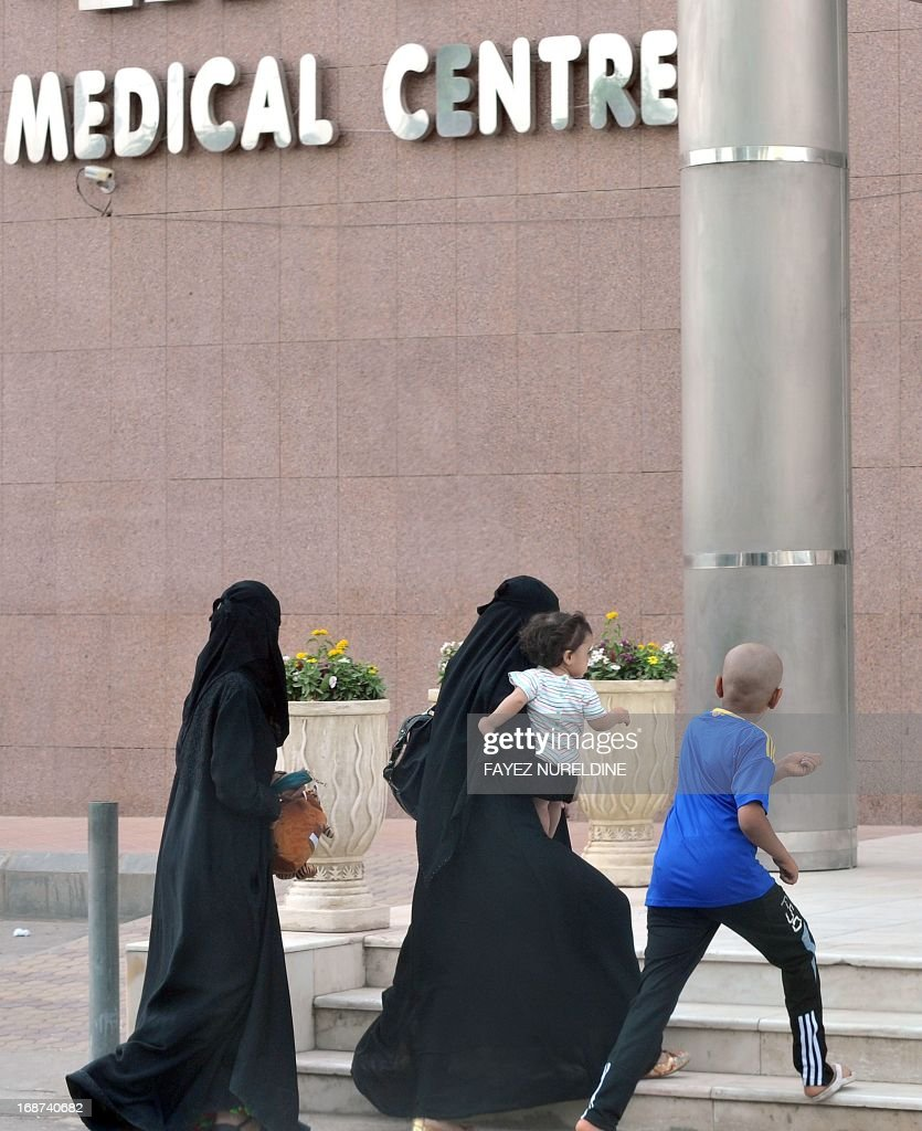 A Saudi family arrive at a hospital in the center of the capital Riyadh, on May 14, 2013. Four more cases of the deadly coronavirus have been detected in Saudi Arabia, the health ministry said, raising the number of people infected from the SARS-like virus in the kingdom to 28, including 15 fatalities.