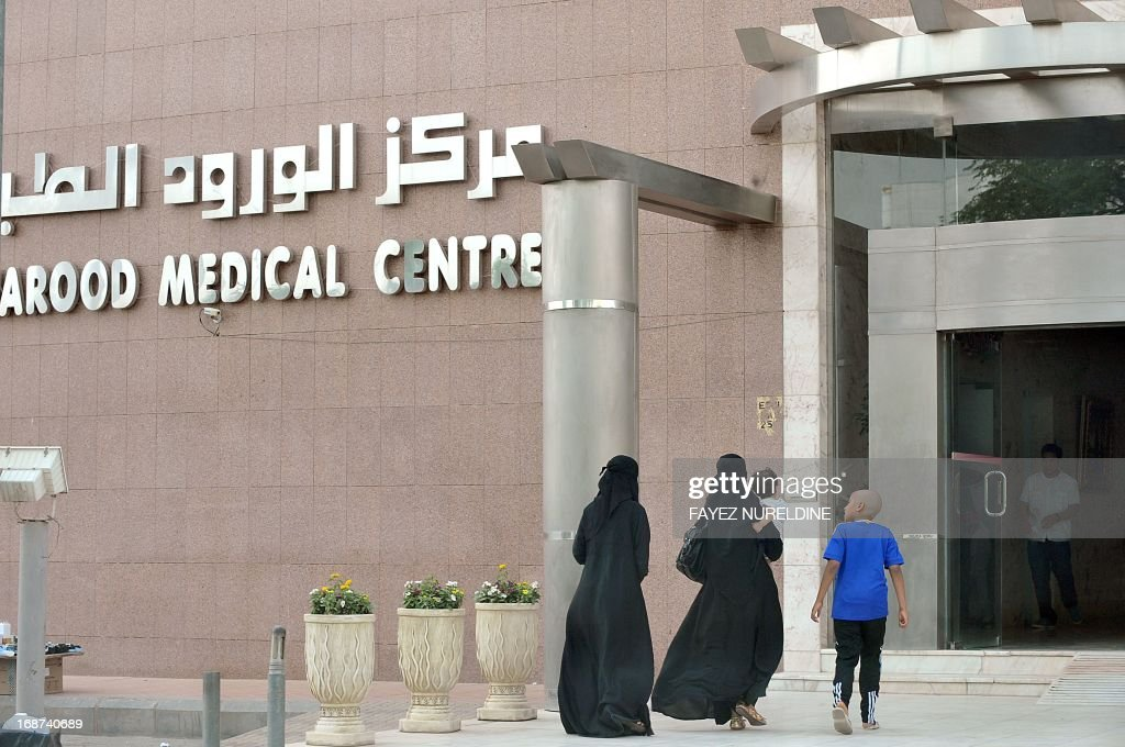A Saudi family arrive at a hospital in the center of the capital Riyadh, on May 14, 2013. Four more cases of the deadly coronavirus have been detected in Saudi Arabia, the health ministry said, raising the number of people infected from the SARS-like virus in the kingdom to 28, including 15 fatalities. AFP PHOTO/FAYEZ NURELDINE