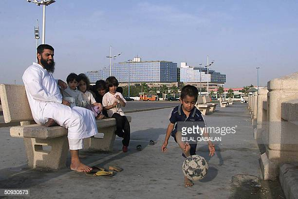 Saudi family sits along the corniche in the Saudi Red Sea city of Jeddah 05 June 2004 The Saudi authorities have launched their own massive clampdown...