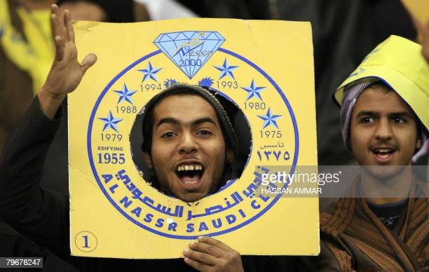 Saudi fans of alNasr club cheer for their team during their football match against alHilal for the Saudi Crown Prince Sultan bin Abdul Aziz alSaud...