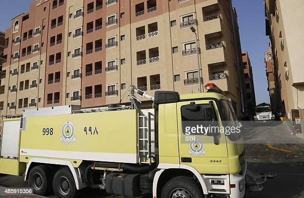 A Saudi firefighter truck is seen next to a residential complex housing employees of oil giant Saudi Aramco after a fire broke out in it killing 11...