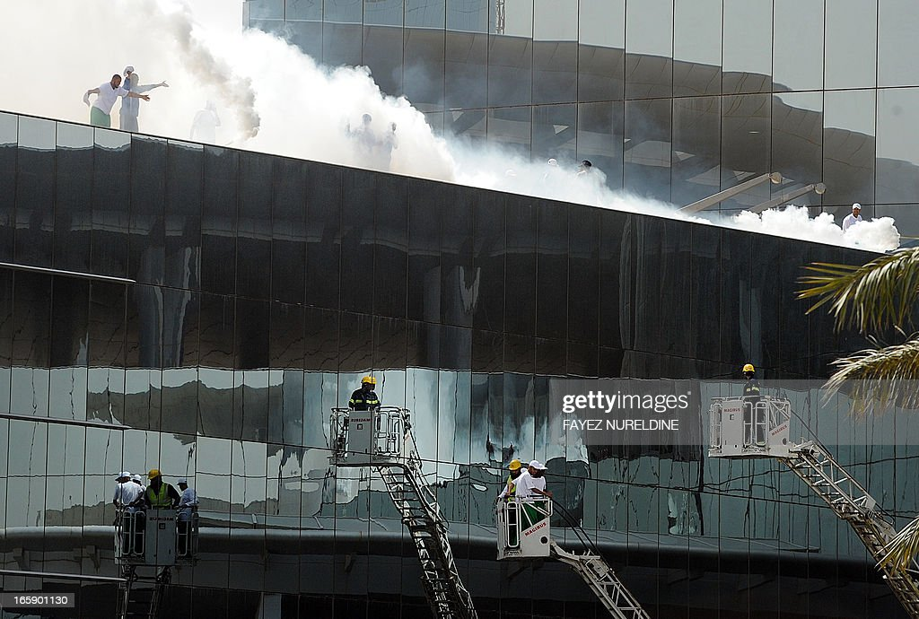 Saudi firefighters and volunteers take part in firefighting exercise during a wide civil defence training at the mall of the Mamlaka tower in the center of Riyadh, on April 7, 2013. Saudi authorities carried out several fire extinguisher trainings in huge malls in Riyadh in anticipation of the outbreak of fires as a result of terrorist or criminal acts.