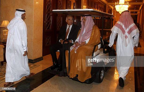 Saudi Foreign Minister Prince Saud alFaisal and his Egyptian counterpart Mohammed Kamel Amr arrive on a buggy to attend the Arab League ministerial...