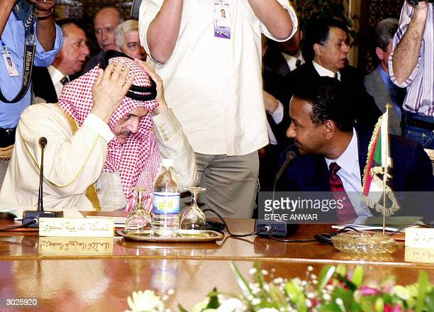 Saudi Foreign Minister Prince Saud alFaisal listens to his Sudanese counterpart Mustafa Osman Ismail prior to the start of the foreign ministers...