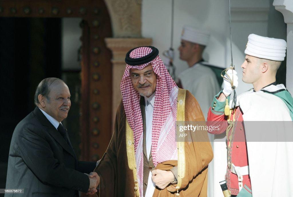 Saudi Foreign Minister Prince Saud bin al-Faisal (R) is greeted by Algerian President Abdelaziz Bouteflika at the Djenane el-Mufti residence in Algiers, on January 30, 2013. AFP PHOTO/FAROUK BATICHE