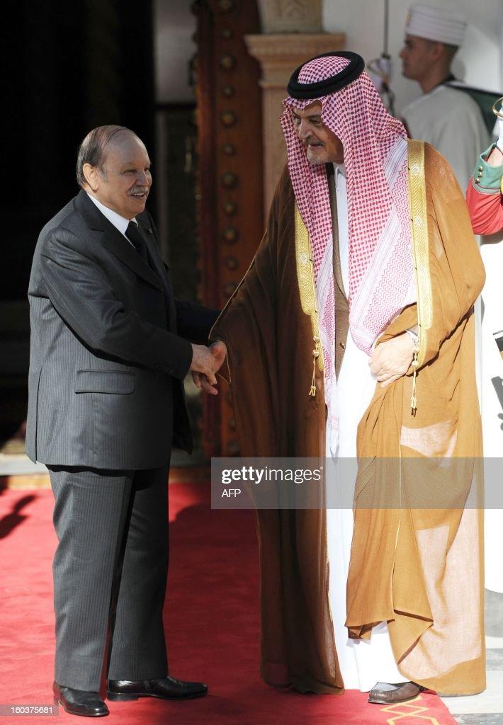 Saudi Foreign Minister Prince Saud bin al-Faisal (R) is greeted by Algerian President Abdelaziz Bouteflika at the Djenane el-Mufti residence in Algiers, on January 30, 2013.