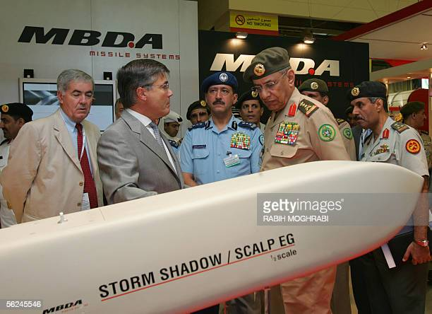 Saudi General Saleh Ali alMuhaya Cheif of Staff of the Saudi Royal Air force looks at a model of the French missile Storm Shadow at the Dubai Air...