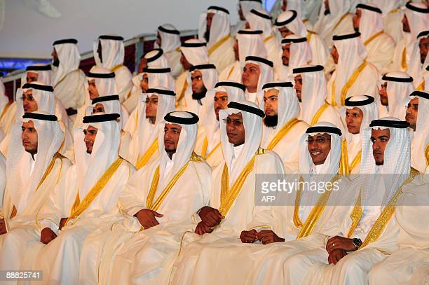 Saudi grooms attend their marriage ceremony during a mass wedding in the Red Sea port city of Jeddah on July 4 2009 One thousand couples were married...