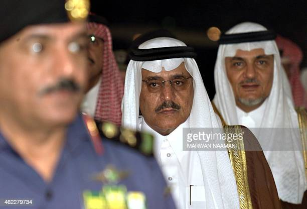 Saudi Interior Minister Prince Nayef bin Abdel Aziz enters the press conference hall escorted by a Saudi officer and Prince Turki alFaysal head of...