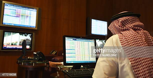 A Saudi investor monitors the stock exchange at the AlBilad Saudi Bank on June 15 2015 in the capital Riyadh Saudi Arabia's stock exchange allowed...