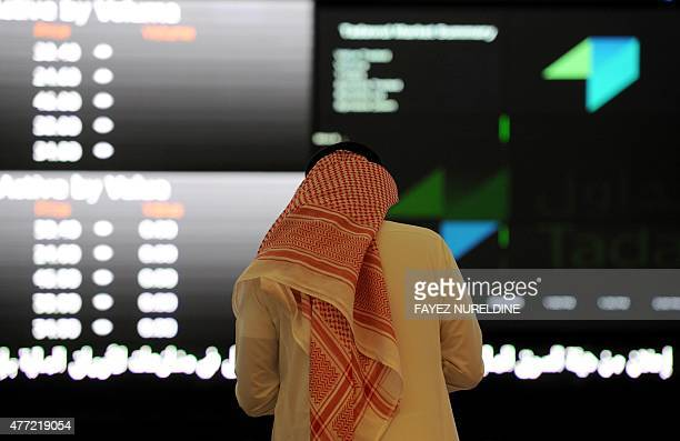 A Saudi investor monitors the stock exchange at the Saudi Stock Exchange or Tadawul on June 15 2015 in the capital Riyadh Saudi Arabia's stock...