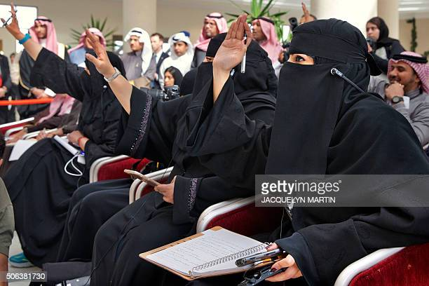 Saudi journalists raise their hands to ask questions during a press conference of Saudi Foreign Minister and US Secretary of State after a meeting of...