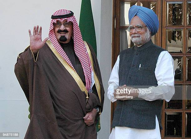 Saudi King Abdullah bin Abdul Aziz alSaud waves to reporters during his meeting with Indian Prime Minister Manmohan Singh in New Delhi India...