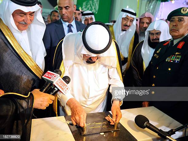 Saudi King Abdullah lays the foundation stone for the development and expansion project of Prophet Mohammed's mosque one of Islam's three oldest...