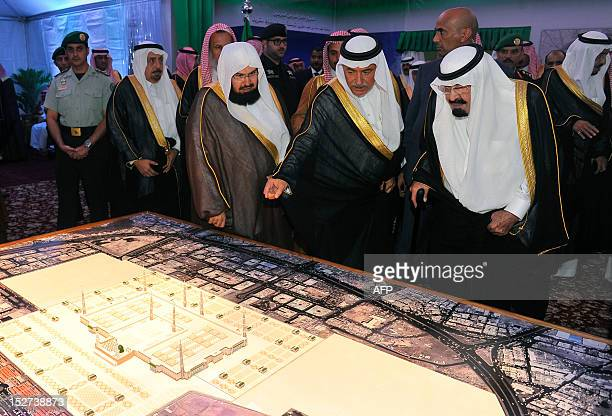 Saudi King Abdullah looks at a model of Prophet Mohammed's mosque one of Islam's three oldest mosques in the world during laying the foundation stone...