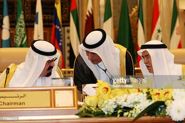 Saudi King Abdullah talks to Saudi Arabia's Oil Minister Ali alNaimi and an unidentified Saudi delegate at the closing of the Third OPEC Summit...