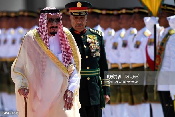 Saudi King Salman bin Abdulaziz inspects a ceremonial guard of honour during a welcoming ceremony at the Parliament House in Kuala Lumpur on February...