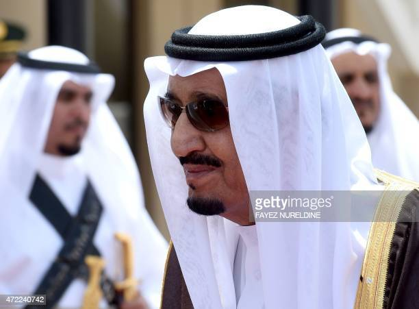 Saudi King Salman bin Abdulaziz looks on during the welcoming ceremony for Qatar's Emir Sheikh Tamim bin Hamad AlThani upon his arrival in Riyadh to...