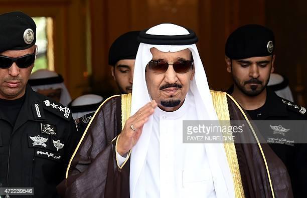 Saudi King Salman bin Abdulaziz walks out to receive Sheikh Mohammed Bin Rashid alMaktoum ruler of Dubai upon his arrival to attend the Gulf...