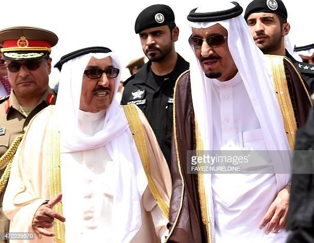 Saudi King Salman bin Abdulaziz welcomes Emir of Kuwait Sheikh Sabah alAhmad alSabah upon his arrival for the Gulf Cooperation Council summit in...
