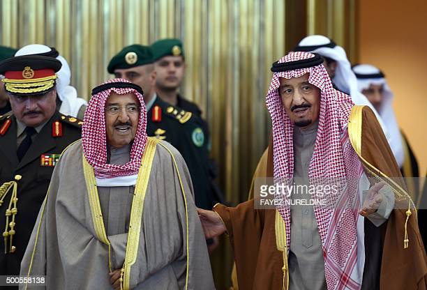 Saudi King Salman bin Abdulaziz welcomes Emir of Kuwait Sheikh Sabah alAhmad alSabah upon the latters arrival to attend the 136th Gulf Cooperation...