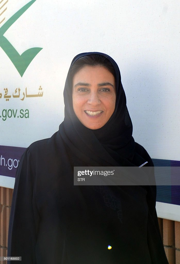 Saudi Lama alSuleiman a candidate for the municipal elections in the Red Sea port city of Jeddah is pictured outside a polling station on December 12...