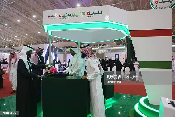 Saudi male representatives of a company wait for female candidates for jobs at a campany's booth during the first annual Bab Rizq Jameel a threeday...