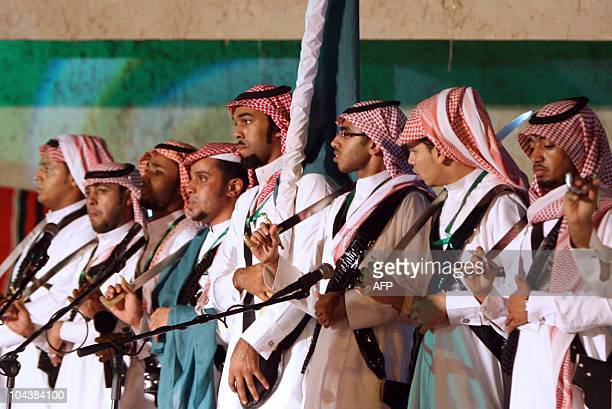 A Saudi male traditional dance troupe performs in the capital Riyadh as Saudis celebrated in a rare burst of patriotic gusto their national day on...