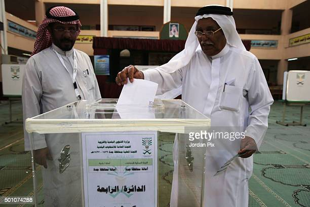 Saudi man arrives at a polling station to vote for the municipal elections on December 12 2015 in Jeddah Saudi Arabia Saudi Women are running the...