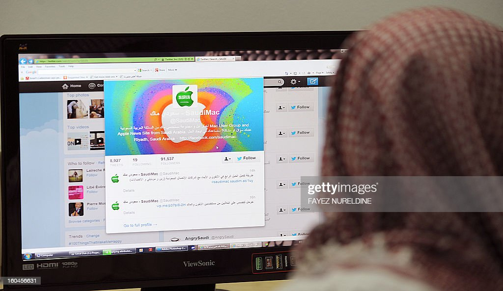 A Saudi man browses through twitter on his desktop in Riyadh, on January 30, 2013. Twitter's unmatched platform for public opinion is emboldening Gulf Arabs to exchange views on delicate issues in the deeply conservative region, despite strict censorship that controls old media.