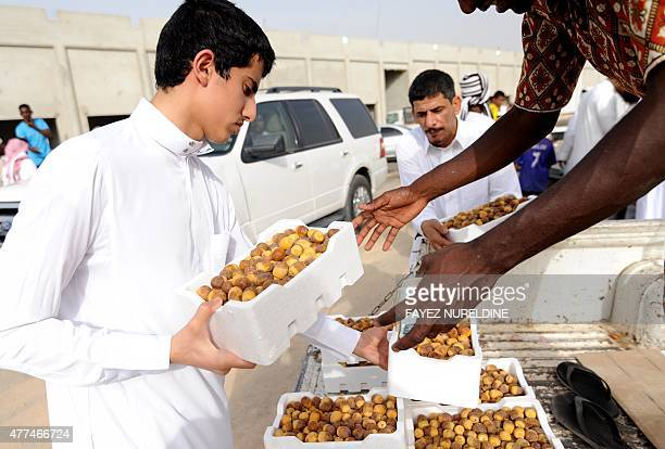 A Saudi man buys dates at Otaiga public market in the Manfouha district of the capital Riyadh on June 17 2015 as the faithful prepare for the start...