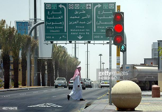 A Saudi man crosses a street in Riyadh 11 July 2004 Saudi Arabia confirmed that the first ever polls in the conservative kingdom would take place as...