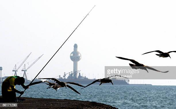 Saudi man fishes on the corniche of the Red Sea port city of Jeddah in 15 November 2005 AFP PHOTO/HASSAN AMMAR