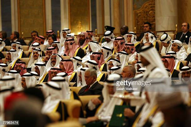 Saudi man offers tea to delegations of the the opening session of the third OPEC Summit on November 17 2007 in Riyadh Saudi Arabia Venezuelan...