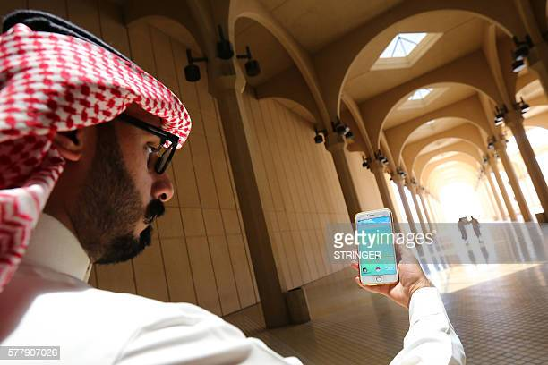 A Saudi man plays with the Pokemon Go application on his mobile in the capital Riyadh on July 17 2016 / AFP / STRINGER