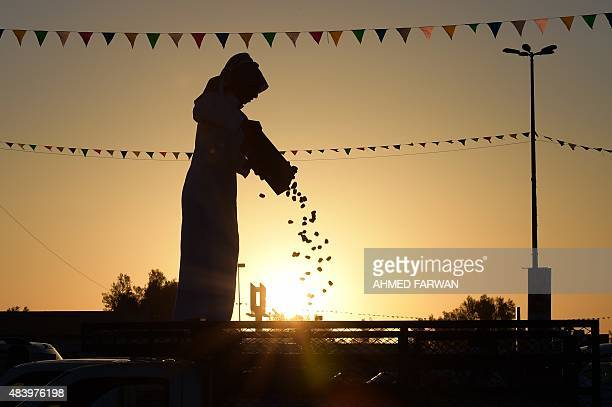 A Saudi man sells dates from the back of their trucks during the first day of the Buraydah Dates Festival in Buraydah 400 kms northwest Riyadh on...