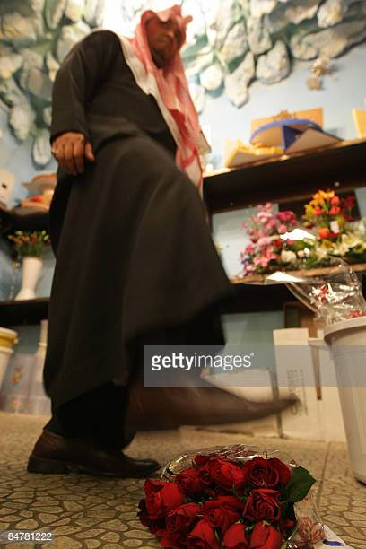 A Saudi man shows how the vice squad crush red roses with their feet as they enforce a law banning Valentine's Day celebrations in the conservative...