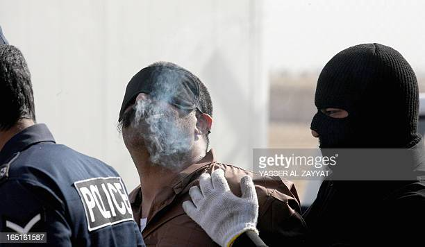 A Saudi man smokes his last cigarette before being hanged for the murder of a compatriot just west of the capital Kuwait City on April 12013...