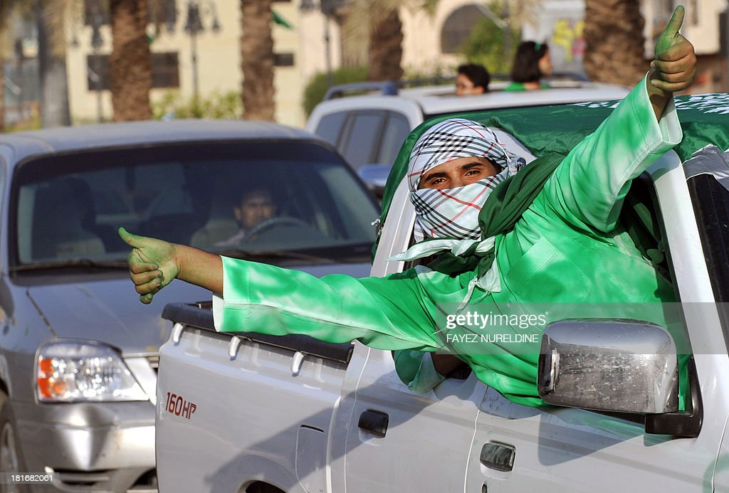 A Saudi man wears an outfit painted in the colors of the national flag as he gestures from a car's window during celebrations marking Saudi Arabian National Day in the desert kingdom's capital Riyadh on September 23, 2013.
