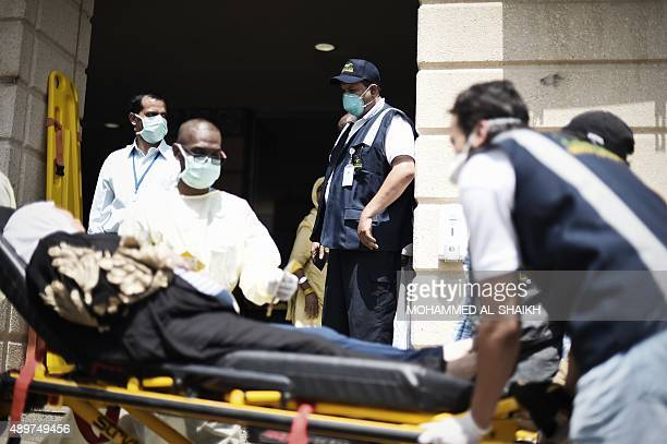 Saudi medics tend to injured pilgrims after they arrived at an emergency hospital following a deadly stampede in Mina near the holy city of Mecca on...