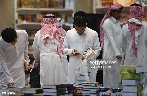 Saudi men browse the annual Riyadh International Book Exhibition in the capital Riyadh on March 17 2016 Over 500 publishing houses and more than 400...