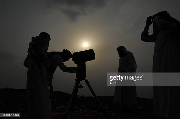 Saudi men gather to spot the moon in the city of Taif on August 10 as Saudi Arabia�s state television AlEkhbariyah announced that the Muslim fasting...
