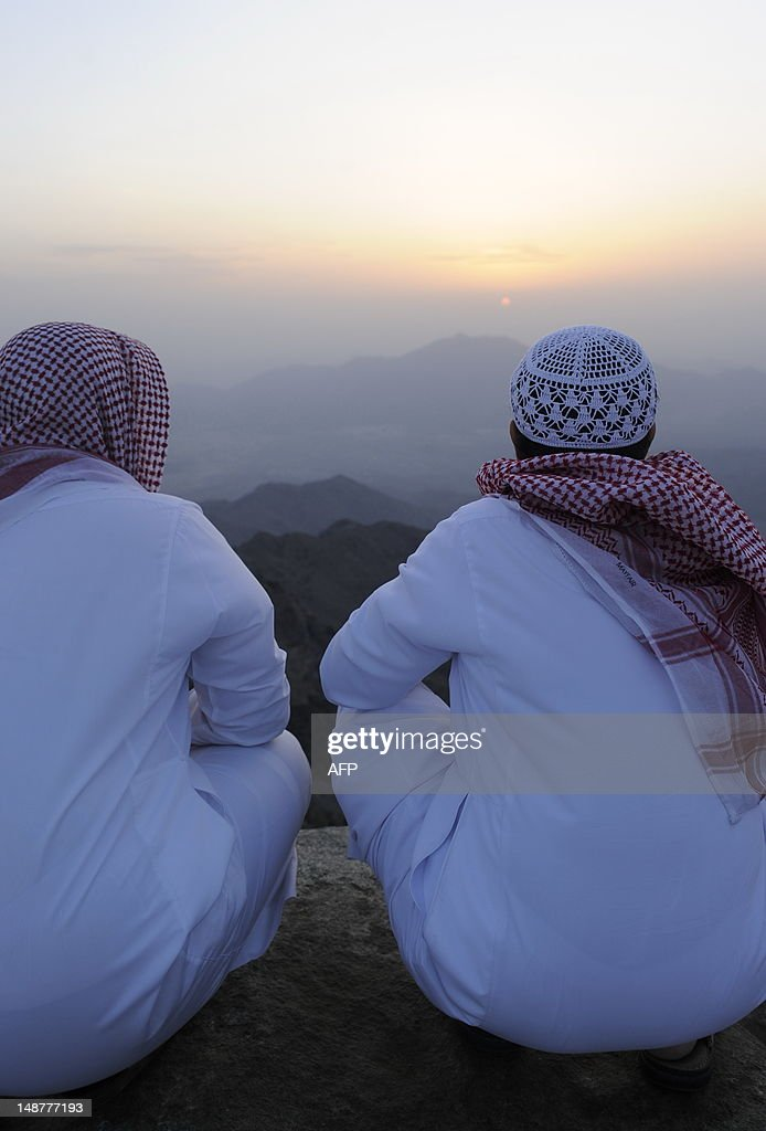 Saudi men sit on a hill and wait to see the new moon of Ramadan as astronomers and scholars of Islam debate when the holy Muslim month of Ramadan begins, in the Saudi city of Taif on July 19, 2012. The start of the fasting month, when the faithful abstain from eating from dawn to sunset, is determined by the sighting of the new moon.