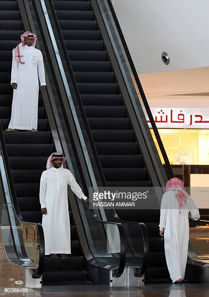 Saudi men use the electric staircase at a shopping mall in the Saudi capital of Riyadh on March 16 2008 AFP PHOTO/HASSAN AMMAR