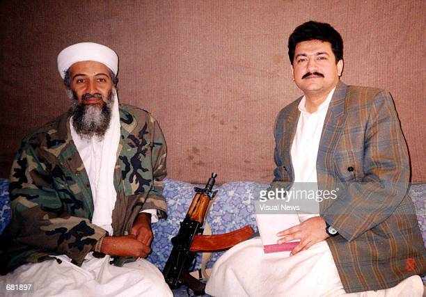 Saudi militant Osama bin Laden sits with Pakistani journalist Hamid Mir during an interview at an undisclosed location in Afghanistan In the article...